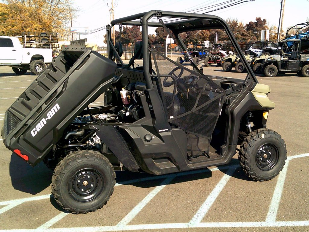A Can-Am Defender HD5 with the dump bed tilted