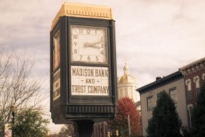 This photo shows the clock tower of the old Madison Bank and Trust building.