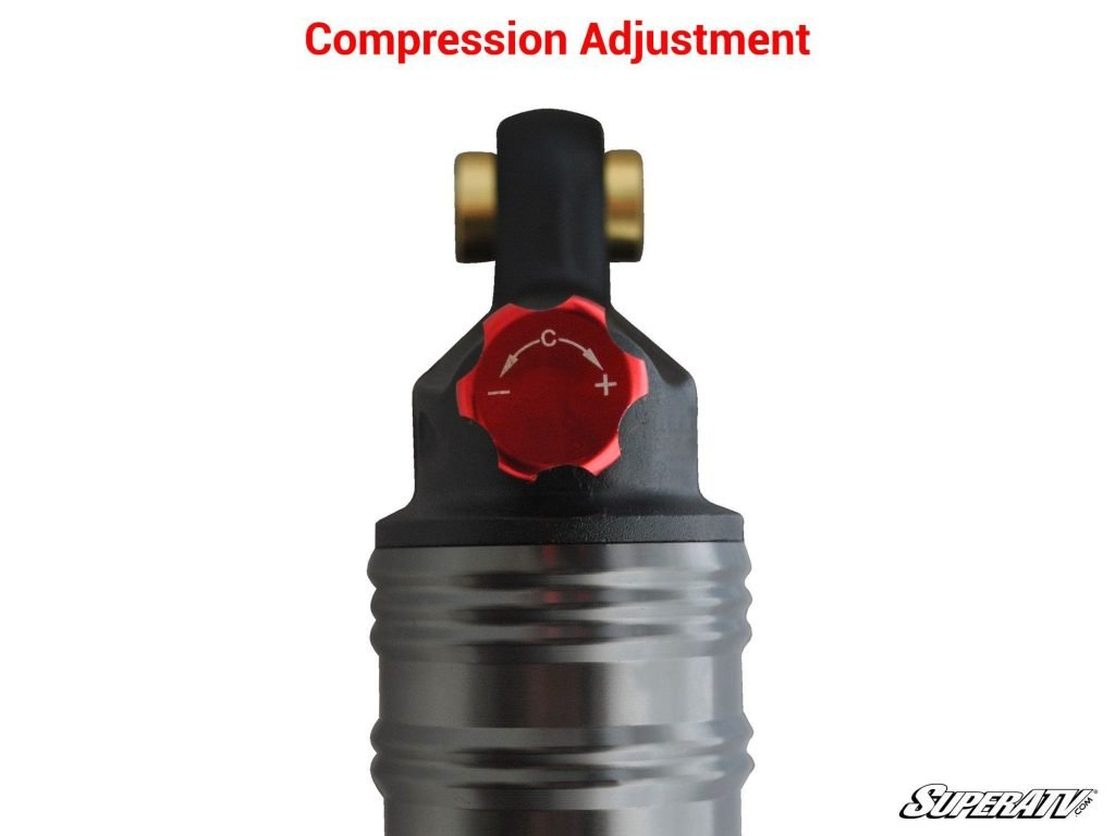 A closeup of the compression adjustment clicker. It may look different on other shocks. Turning it clockwise makes the shock stiffer when it compresses. Turning it counterclockwise makes it softer.