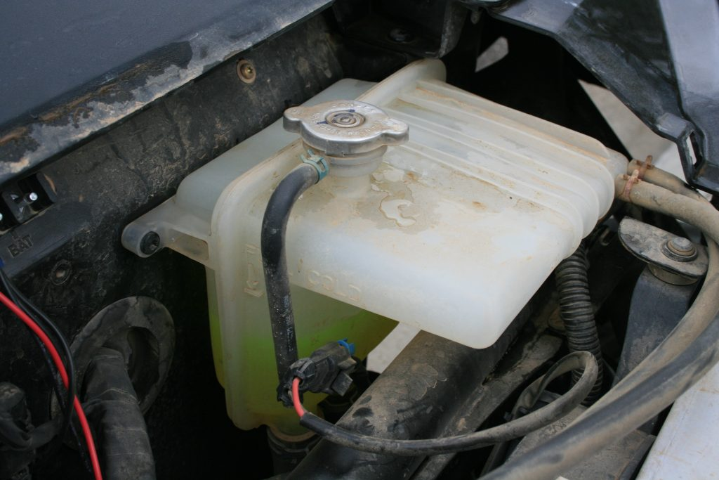 This photo shows the coolant in a side-by-side, which is a bright green color. The color and density of the coolant can tell you how well the vehicle has been taken care of.