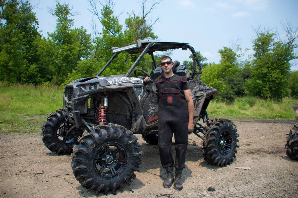 A SuperATV customer poses with his RZR 900 Trail after installing a set of SuperATV portals on his machine.