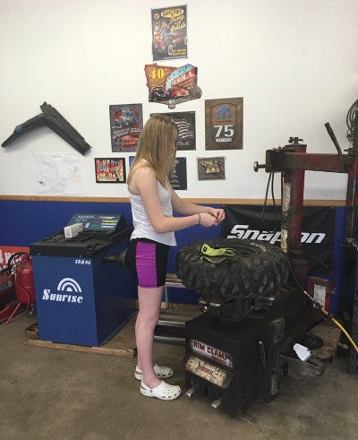 Shawn's daughter mounting tires