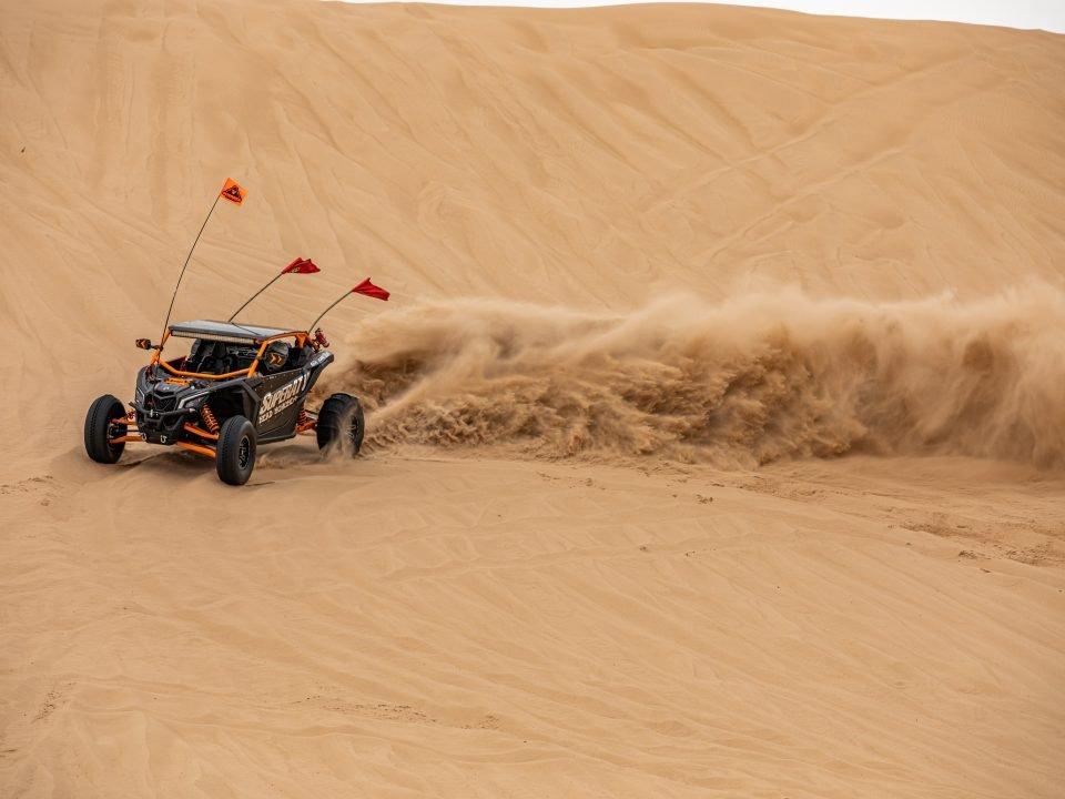 A UTV riding through the desert