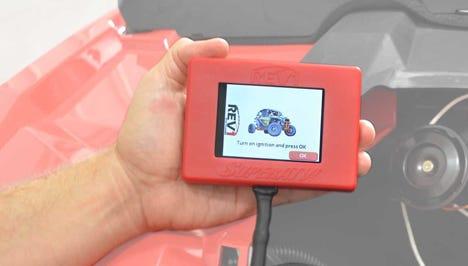Hand Holding a SuperATV ECU Tuner