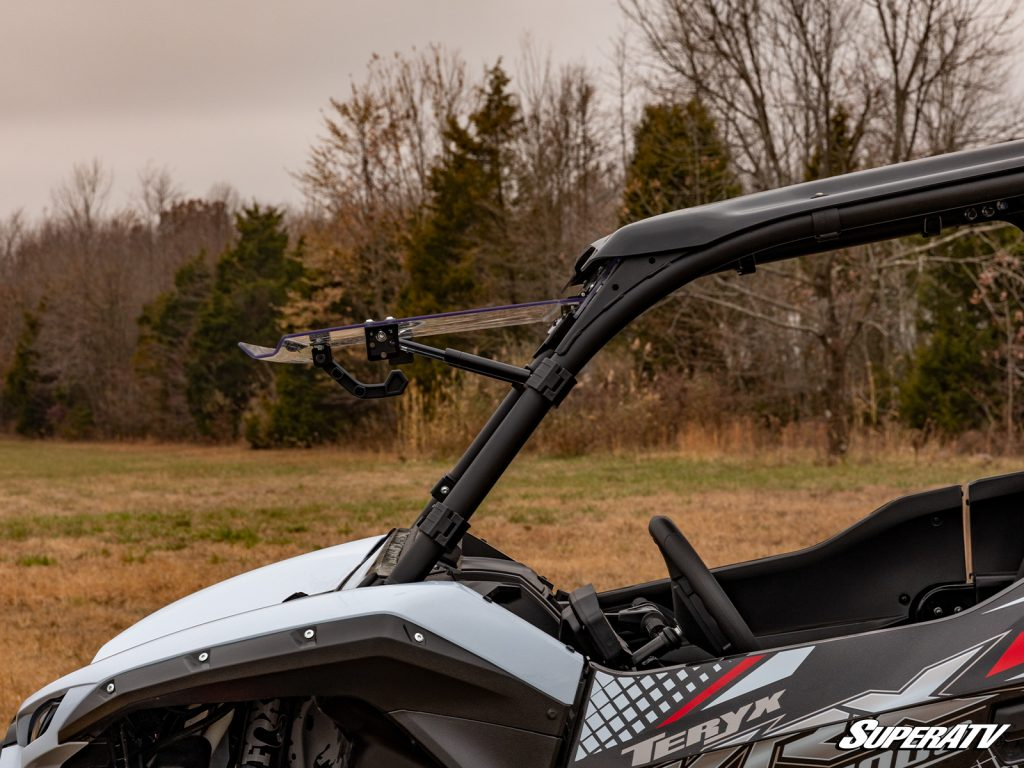 """A flip windshield set to the """"open"""" position, installed on a Kawasaki Teryx KRX 1000"""