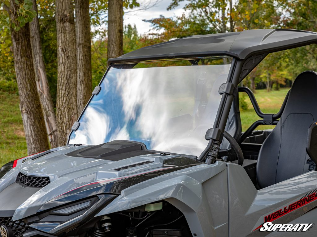 A close-up shot of a full windshield on a Yamaha Wolverine