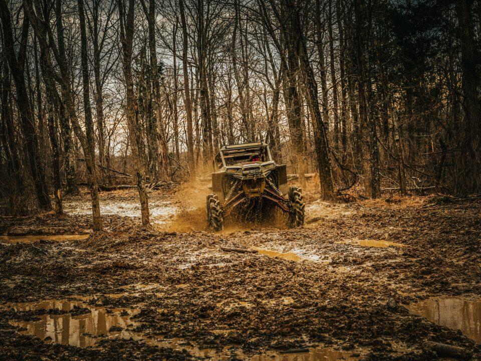 side-by-side in mud