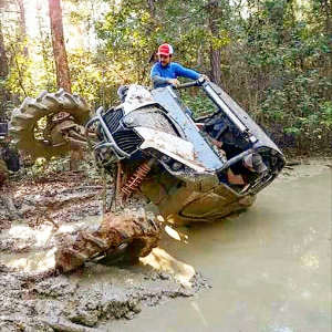 This photo shows Goose Bellows with his portal gear lift nearly sideways in a mud pit.