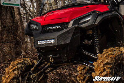 This photo shows the custom front bumper that was designed for this Honda Pioneer 1000 build.