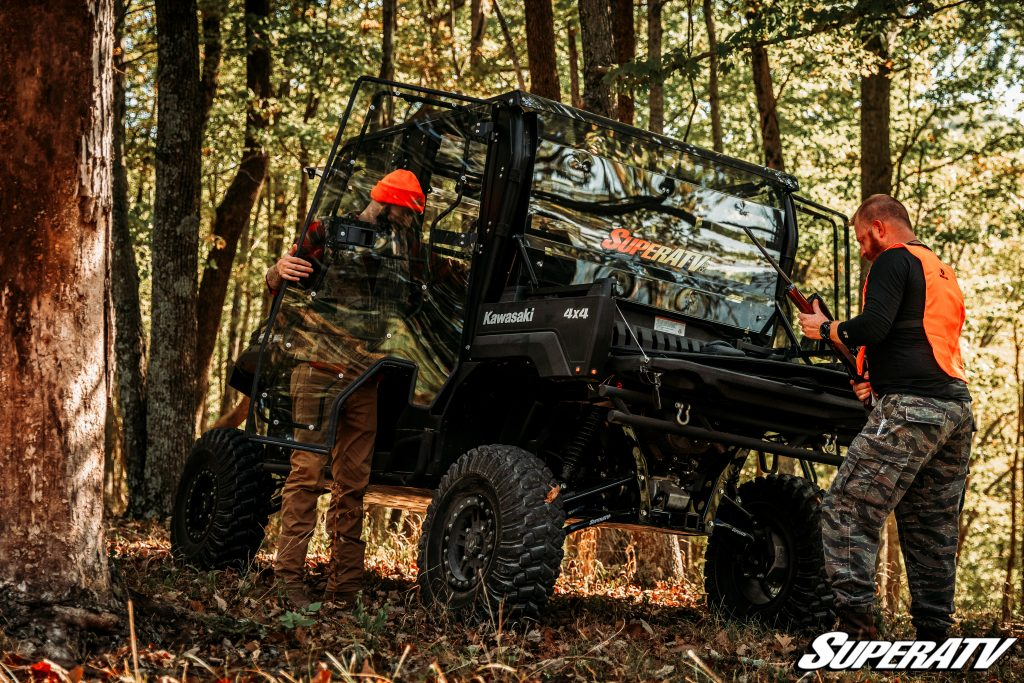 Two hunters grab their gear out of a side-by-side. Off-road machines make hunting way easier and more enjoyable.