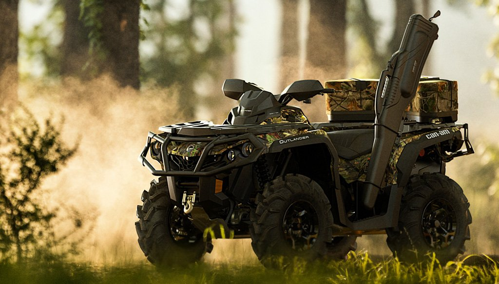 This camo Can-Am Outlander is equipped with a winch, a gun holder, and some rear storage solutions. What more could you need for your next hunt?