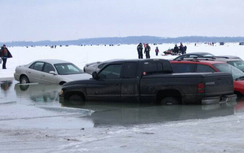 Two many cars parked in one spot breaking through otherwise very thick ice.