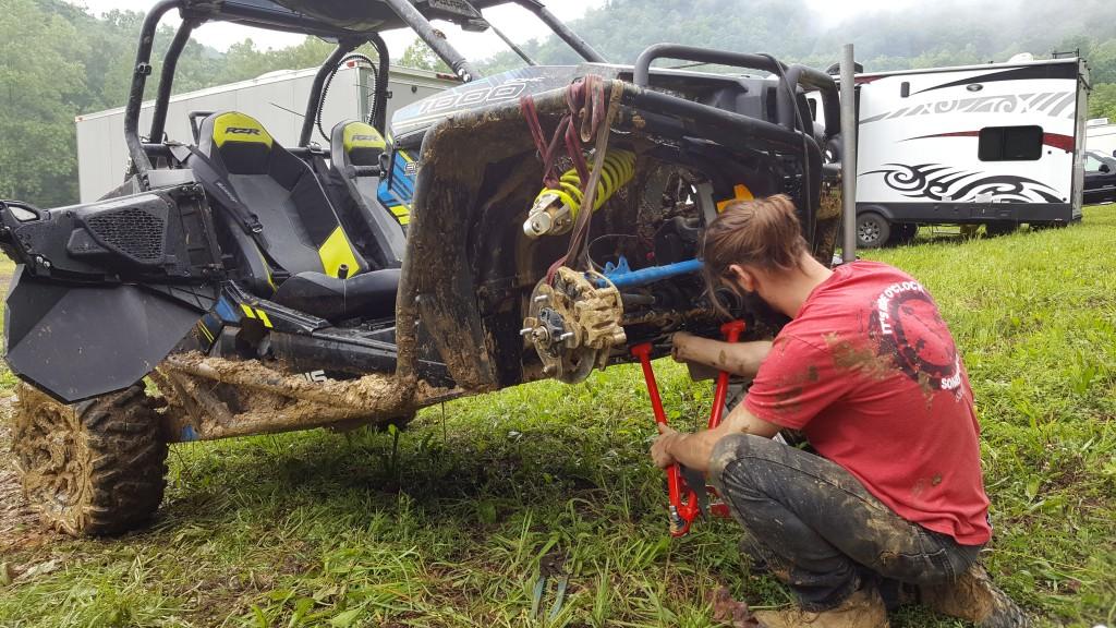 This photo shows Justin Eaton working on his Polaris RZR XP 1000.