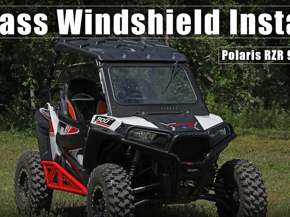 A Polaris RZR 900 with a SuperATV Glass Windshield installed