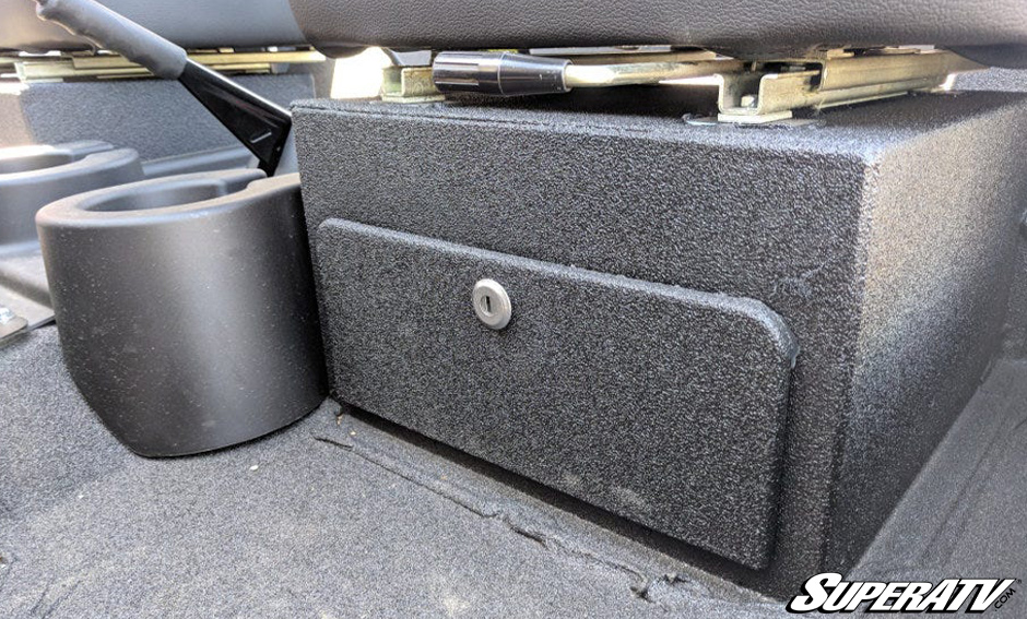 There are lock boxes under the seats.