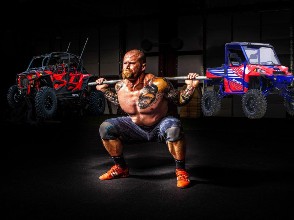Weightlifter lifting two UTVs