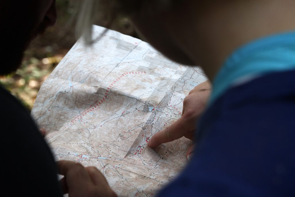 A person looking at a paper map