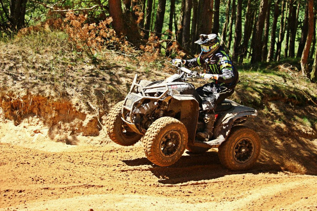 An ATV on a dirt trail with wide off-road tires.