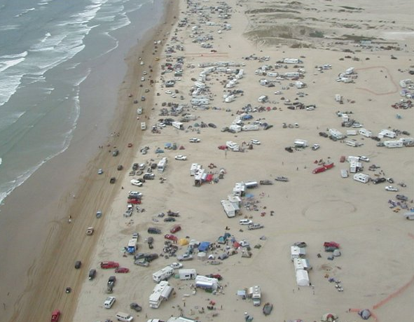 Vehicles cover the beach at Oceano Dunes