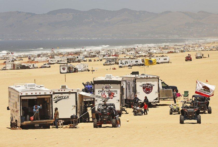 ATVs, UTVs, and RVs fill the beach at Oceano Dunes in California