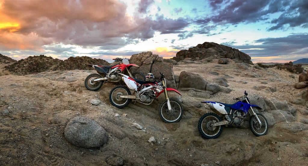 Dirt bikes parked on the rocks at Ocotillo Wells SVRA
