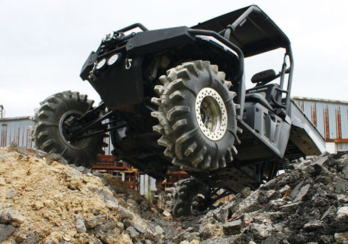 A UTV gets off camber by elevating the front driver's tire in the air