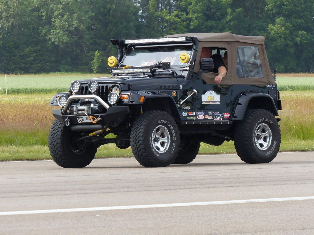 A Jeep Wrangler upgraded for offroad use that still runs on the road.