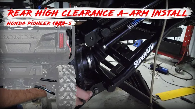 High clearance rear offset A-arms being installed on a Honda Pioneer 1000