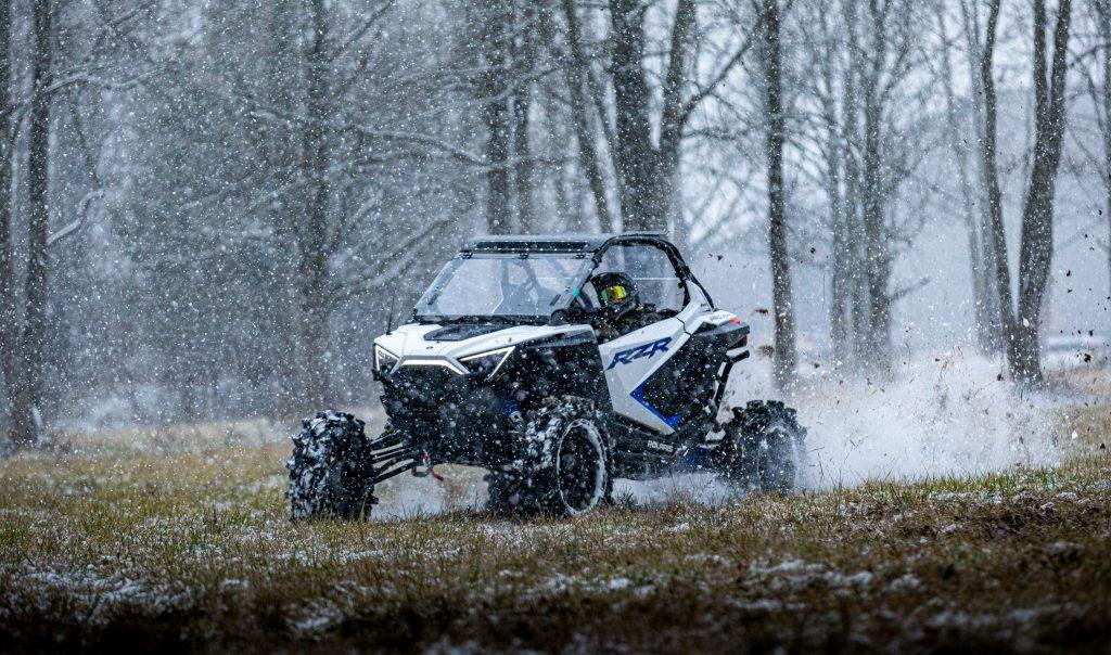 Polaris RZR PRO XP riding in the snow.