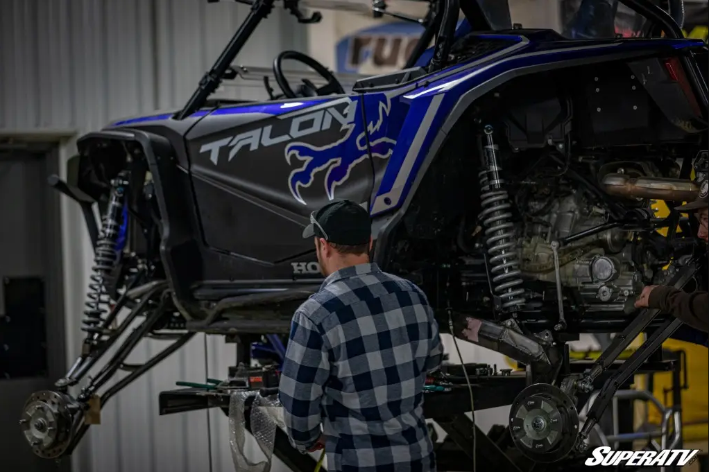 A rider making his Honda Talon quiet with some routine maintenance.