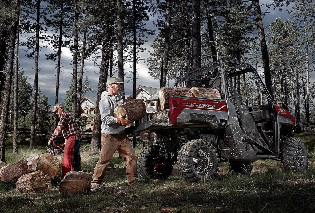 A Polaris Ranger XP 1000 being used to haul firewood