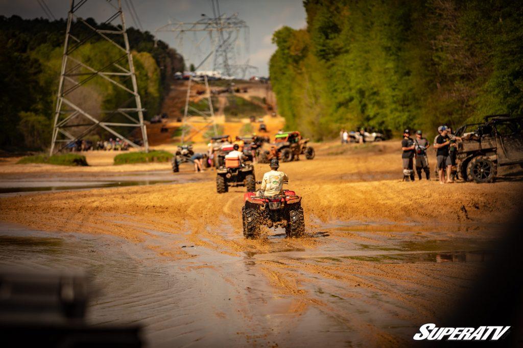 ATVs and UTVs on a muddy trail at River Run ATV Park
