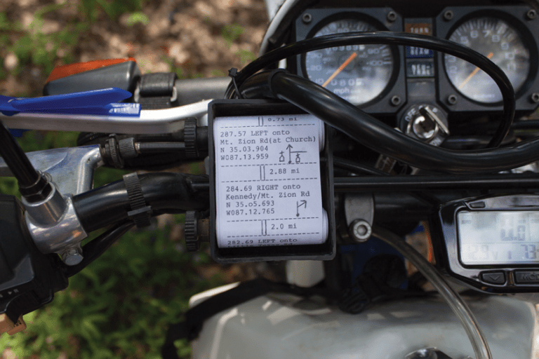 This photo shows a roll chart, loaded with step-by-step directions, installed on a motorcycle.