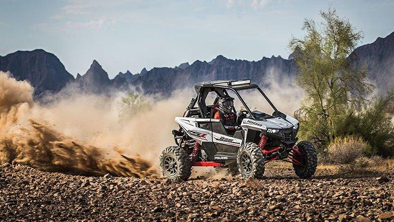 A 2018 Polaris RZR RS1 navigating rocky desert.