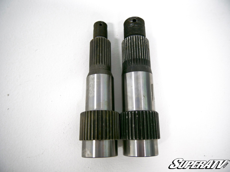 A photo comparing Gen 1 and Gen 2 portal output shafts
