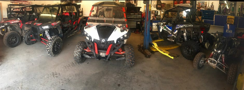 Shawn's shop is all full up with Polaris RZRs, Mavericks and quads