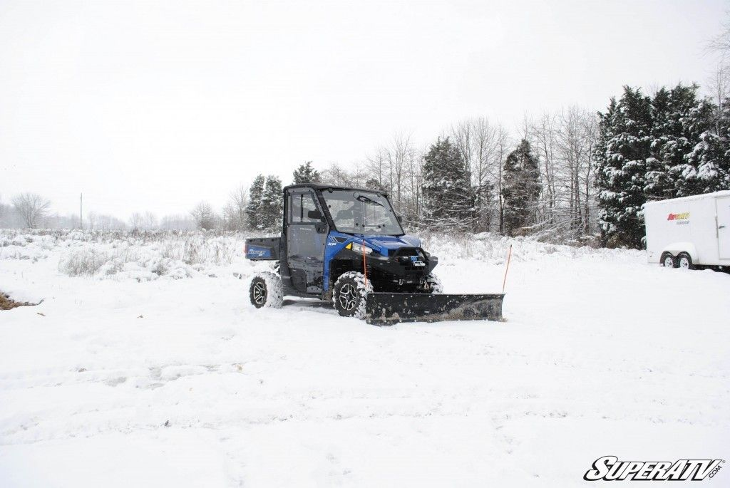 A snow plow on a Polaris Ranger makes  clearing your driveway and street easy.