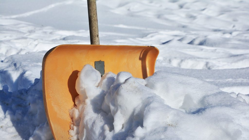 A shovel scooping up snow