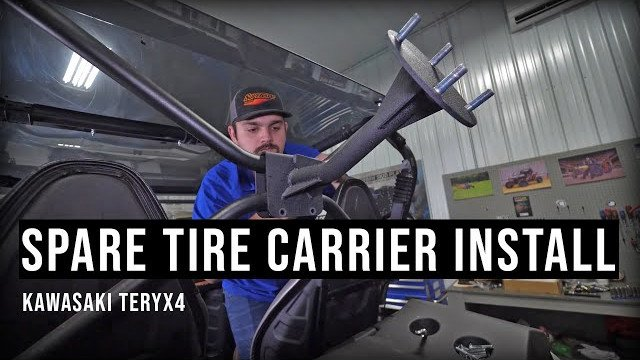 Braden installing a spare tire carrier on a Kawasaki Teryx 4