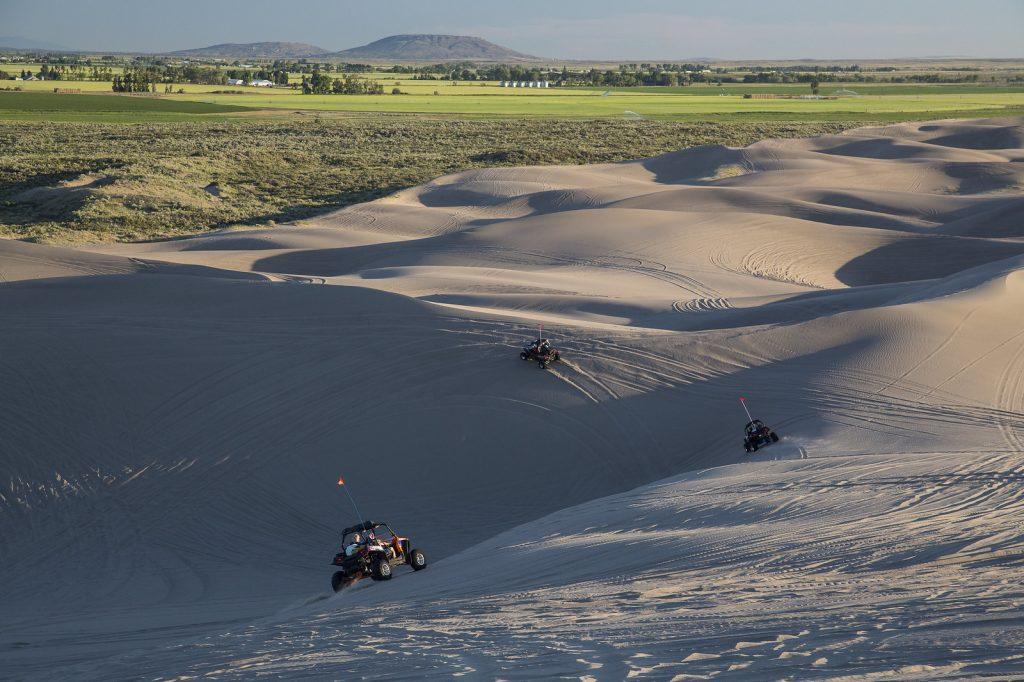 3 UTVs on the St. Anthony sand dunes.