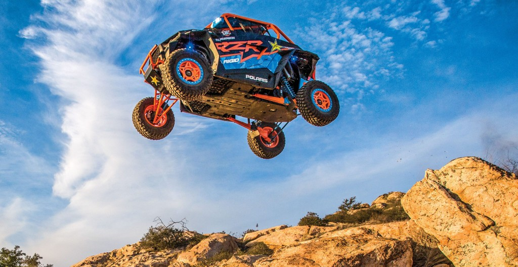 RJ Anderson performing a stunt in his RZR