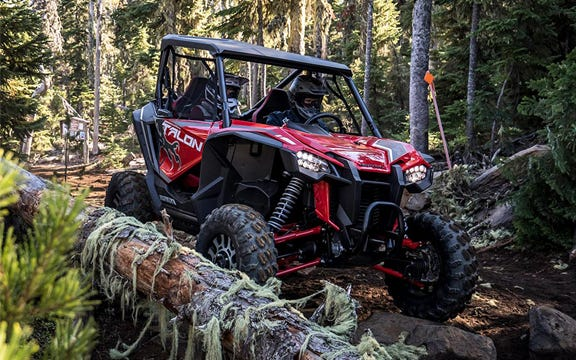 The Honda Talon parked in the middle of a forest