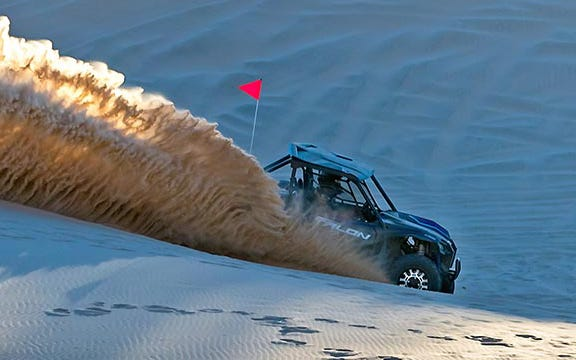 The Honda Talon kicks up a rooster tail in the dunes