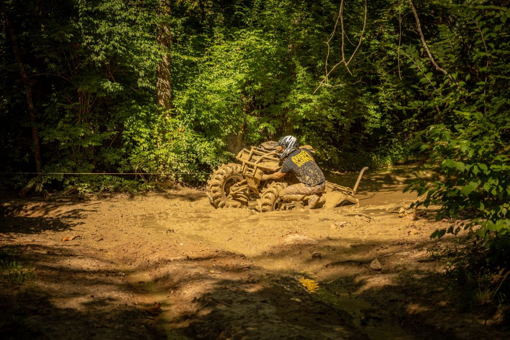 Using an ATV winch to get unstuck out of the mud.