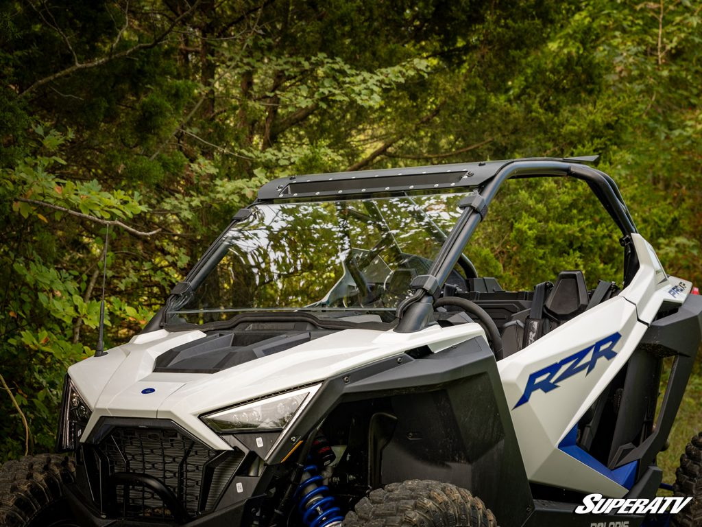 A full windshield installed on a Polaris RZR PRO XP